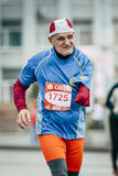Old man runner one-armed disabled person running down street Royalty Free Stock Images