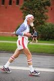 Old man runs on Kremlin embankment Stock Image