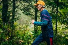 Old man runs Royalty Free Stock Photo