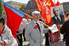Old man with russian flag and newspapers takes part in the May day demonstration in Volgograd. Volgograd, Russia - May 1, 2017: Old man with russian flag and Royalty Free Stock Image
