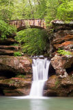 Old Man's Cave Waterfall and Bridge Royalty Free Stock Photography