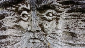 Old man's face in stone. Old man's face carved in stone Royalty Free Stock Photos