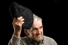 Old man saluting Royalty Free Stock Photography