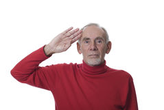 Old man saluting in respect Stock Images