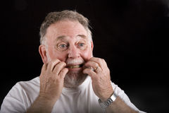 Old Man Scratching Face Stock Photo