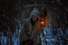 Old man with a scythe. Old man with the scythe induces horror, this is a deadly sign Royalty Free Stock Photos
