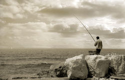 Old man and the sea. Picture taken in Jaffa, Israel Royalty Free Stock Image