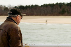 The old man by the sea. Royalty Free Stock Image
