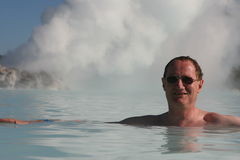 The Old Man of The Sea. Boiling steam jets heat up a pool in Iceland stock photography