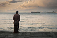 Old man and sea view Stock Photos