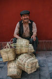 The old man selling bamboo baskets in the street in ludin,sichuan,china. The old man selling bamboo baskets in the street is taken in ludin,sichuan,china royalty free stock photo