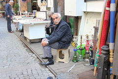 Istanbul, Turkey - Old man selling hookah pipes at the street stock photo