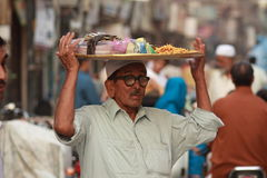 Old man selling spices at a bazaar Stock Photo