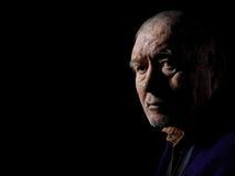 Old man senior. Serious old man senior on black background looking at camera Royalty Free Stock Images