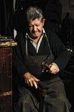 Old man, shoemake Stock Photo