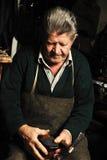 Old man, shoemaker, repairing old handmade Royalty Free Stock Images