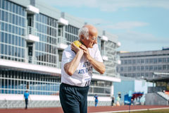 Old man shot put Royalty Free Stock Photography