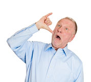 Old man showing a drunk hand sign Royalty Free Stock Photo