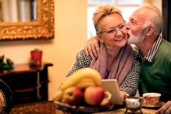 Old man showing his wife what is true love, senior couple in lov Stock Image