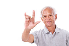Old man showing love hand sign Royalty Free Stock Image