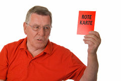 Old man showing red card Royalty Free Stock Photos