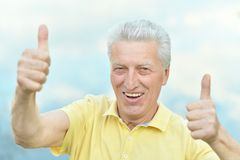 Old man showing Royalty Free Stock Images