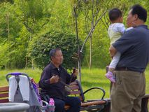 The old man shows the erhu Stock Images
