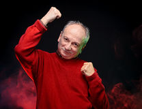 Old man shows fists Royalty Free Stock Image