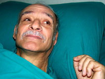 Old man sick hospital bed Stock Photography