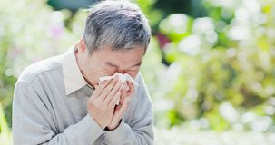 Old man sick and sneeze stock images