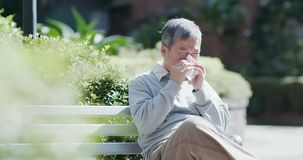 Old man sick and sneeze royalty free stock images