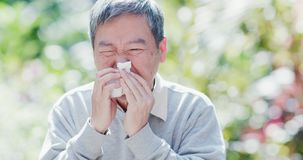 Old man sick and sneeze stock image