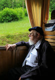 The old man in the sightseeing train,the alps,switzerland Royalty Free Stock Photos
