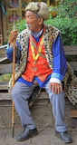 Old man is sititng on a bench, Lijiang, China Royalty Free Stock Photography