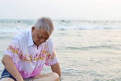 Old man sits on the beach Royalty Free Stock Photography