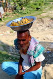 Old man is sitting with banana. Old man is doing small banana business to the people who go to Nijhum Dwip at Hatiya upazila. It is situated in Noakhali District stock images