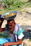 Old man is sitting with banana. Old man is doing small banana business to the people who go to Nijhum Dwip at Hatiya upazila. It is situated in Noakhali District royalty free stock photos