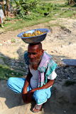 Old man is sitting with banana. Old man is doing small banana business to the people who go to Nijhum Dwip at Hatiya upazila. It is situated in Noakhali District stock image