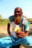 Old man is sitting with banana. Old man is doing small banana business to the people who go to Nijhum Dwip at Hatiya upazila. It is situated in Noakhali District royalty free stock image