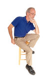 Old man sitting on chair thinking. Royalty Free Stock Images