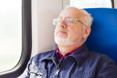 Old Man Sitting Near The Window In The Carriage Stock Photography