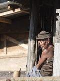 Old Man sitting outside his house  at Khonoma Village on 4th Dec 2016 at Khonoma Village,nagaland. Old Man sitting outside his house at Khonoma Village on 4th stock photography