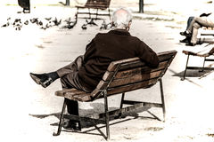 Old man Is Sitting On The Park Bench. Göztepe,Izmir,Turkey-October 16,2016 : An old man is sitting on the park bench and looking around at the park of Göztepe Stock Photo