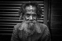 Old man sitting in the street of Kathmandu, Nepal stock images