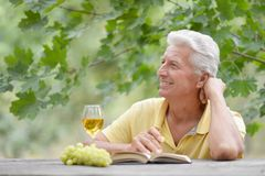 Old man sitting Stock Photography