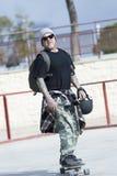 Old man skater arriving Stock Images