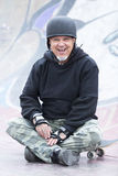 Old man skater smiling Royalty Free Stock Photos
