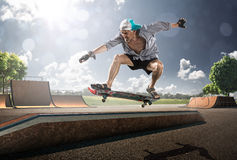 Old Man skating in sunny day. Extreme old Man skating in skatepark Royalty Free Stock Photos