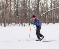 Old Man Skiing in Cross Country Winter Snow Stock Photos