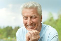 Old man and skyr Royalty Free Stock Image